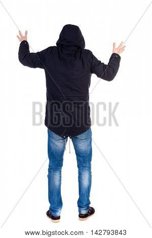 Back view of  man.  Raised his fist up in victory sign.   Rear view people collection.  backside view of person.  Isolated over white background. A guy with a hood on his head while wearing someone