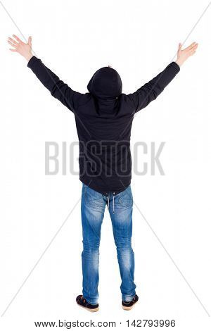 Back view of  man.  Raised his fist up in victory sign.   Rear view people collection.  backside view of person.  Isolated over white background. The guy while wearing a hood on his head to pray to