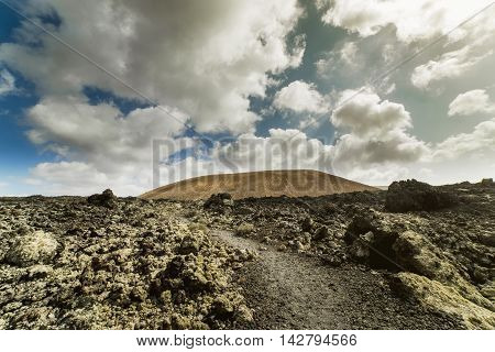 Road to vulcano Caldera Blanca, a volcano on Lanzarote, in the Spanish Canary Islands.