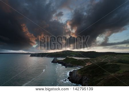 Sunset over Three Cliffs Bay on the Gower peninsula, Swansea