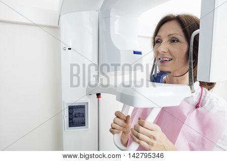 Patient Using Digital Panoramic Xray Machine While Looking Away