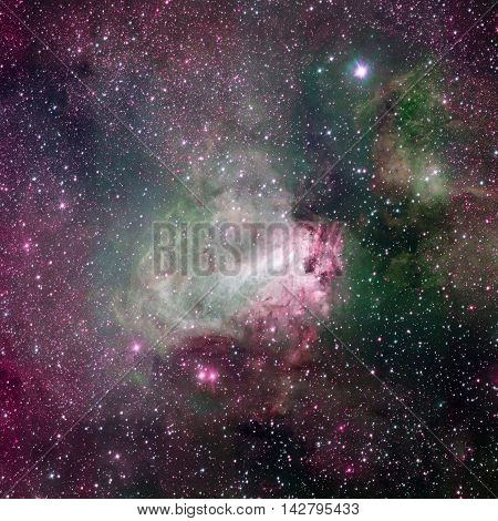 Star-forming region Messier 17, also known as the Omega Nebula or the Swan Nebula. This vast region of gas, dust and hot young stars lies in Milky Way. Elements of this image furnished by NASA.
