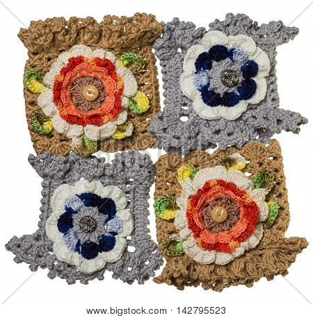 Four hand-knitted bracelets with flower staggered together