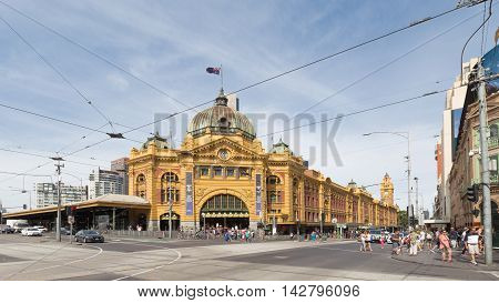 Melbourne - February 23 2016: View of the train station Flinders Street Station with a clock and a lot of people around February 23 2016 Melbourne Australia