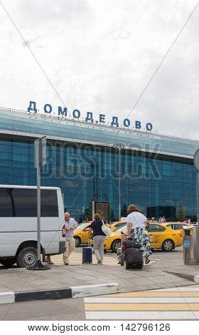 The Moscow region - 31 July 2016: Large modern passenger terminal at Domodedovo airport waiting for passengers cars and people with suitcases 31 July 2016 Moscow region Russia