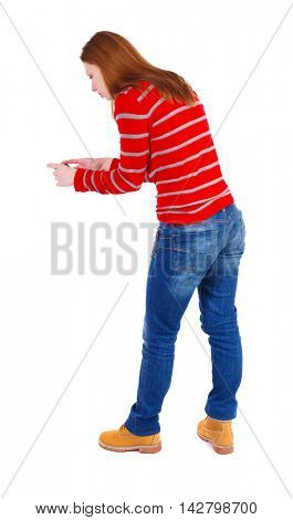 back view of standing young beautiful  woman  using a mobile phone. girl  watching. Rear view people collection.  backside view of person.  Isolated over white background. The blonde in a red striped