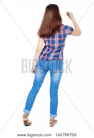 back view of writing beautiful woman. Rear view people collection.  backside view of person. Isolated over white background. Girl in plaid shirt stands with his back and wrote marker