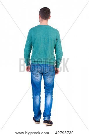 Back view of going  handsome man. walking young guy . Rear view people collection.  backside view of person.  Isolated over white background. A man in a jacket and a green jacket went off.
