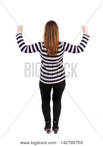Back view of  woman.  Raised his fist up in victory sign.    Raised his fist up in victory sign.  Rear view people collection.  backside view of person.  Isolated over white background. Girl in a
