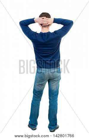 back view of Business man  looks.  Rear view people collection.  backside view of person.  Isolated over white background. bearded man in blue pullover standing with his hands behind his head.