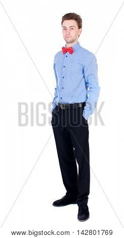 Smiling businessman in a bow tie looking up. top view. Isolated on white background. Proud businessman standing with his hands in his pockets.