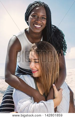 Close up portrait of two multiracial teen girlfriends together outdoors.