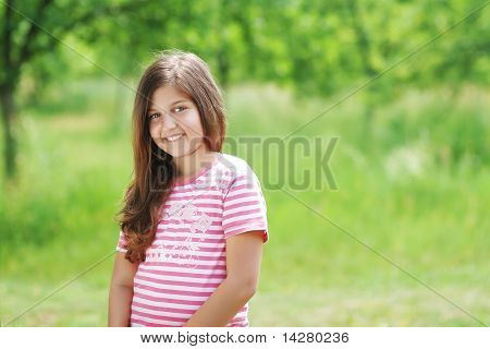 Girl in the green field