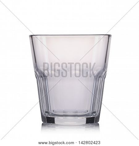 Empty old fashioned cocktail glass on a white background.
