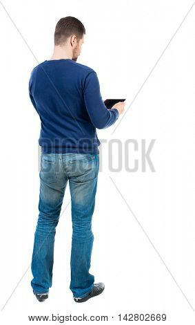 back view of business man uses mobile phone.    rear view people collection. Isolated over white background. backside view of person. bearded man in blue pullover reads from the tablet.
