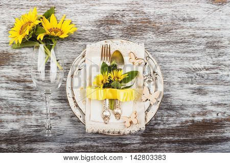 Tableware And Silverware With Sunflowers