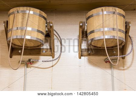 two buckets on a rope sauna finish cold shower of pails