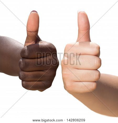 Macro close up of two female hands doing thumbs up symbol.Front view of diverse multiracial hands together isolated on white background.