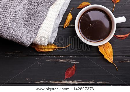 Sweaters yellow leaves and hot coffe top view. Autumn consept.