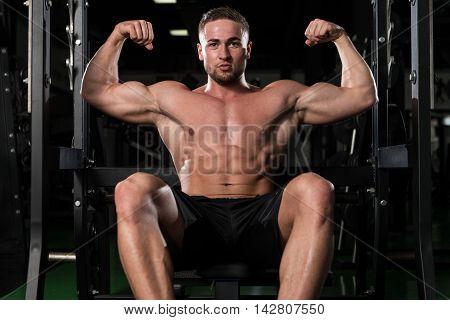 Bodybuilder Man Posing In The Gym