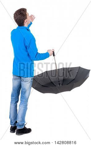 young man in in a white knit sweater under an umbrella. Rear view people collection.  backside view of person.  Isolated over white background. Curly boy in the blue jacket checks whether the rain