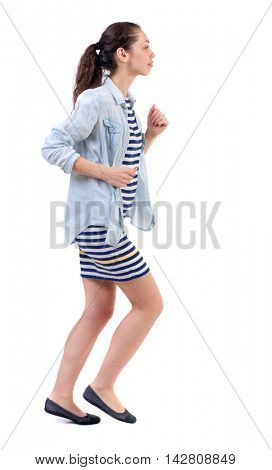 side view of running  woman. beautiful girl in motion. backside view of person.  Rear view people collection. Isolated over white background. Swarthy girl in a checkered dress runs in the side