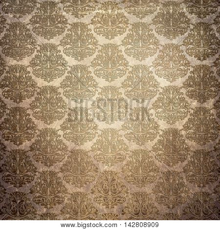 Old grunge paper background with old-fashioned patterns. Vintage wallpaper background.