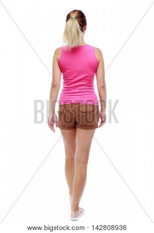 back view of walking  woman. beautiful blonde girl in motion.  backside view of person.  Rear view people collection. Isolated over white background. Sport blond in brown shorts goes back frame.