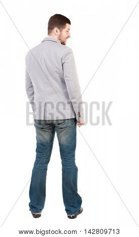 back view of Business man  looks.  Rear view people collection.  backside view of person.  Isolated over white background. A guy in a gray jacket looking sideways.