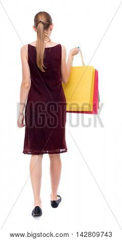 back view of going  woman  with shopping bags . beautiful girl in motion.  backside view of person.  Rear view people collection. Isolated over white background. The girl in the maroon sleeveless
