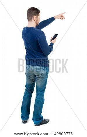 Back view of  pointing young men talking on cell phone. Young guy  gesture. Rear view people collection.  backside view of person.  Isolated over white background. bearded man in blue pullover holding
