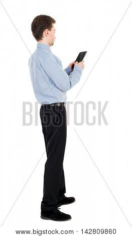 back view of business man uses mobile phone.    rear view people collection. Isolated over white background. backside view of person. The curly-haired businessman in light shirt works on the tablet.