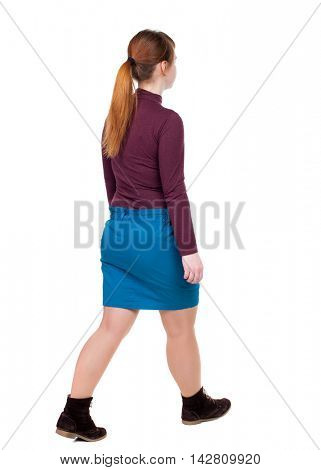 back view of walking  woman. beautiful blonde girl in motion.  backside view of person.  Rear view people collection. Isolated over white background. The red-haired girl in a blue skirt goes sideways.