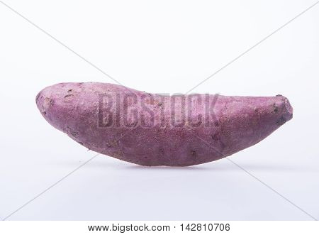Sweet Potato Or Red Sweet Potato On A Background.