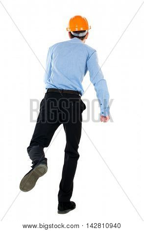 Back view of running engineer in helmet. Walking guy in motion. Rear view people collection. Backside view of person. Isolated over white background. Businessman in a blue shirt and a helmet moves