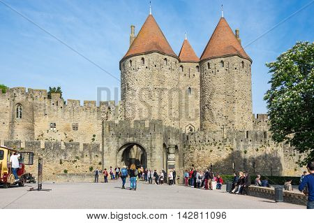 CARCASSONNE FRANCE - MAY 05 2015: Medieval gate to old castle of Carcassonne Languedoc-Roussillon France