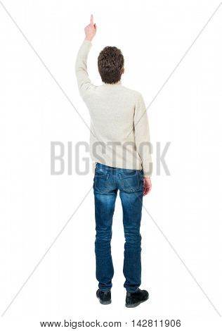 Back view of pointing business man.  Rear view people collection.  backside view of person.  Isolated over white background. Curly short-haired guy in a white jacket wool saw something at the top.