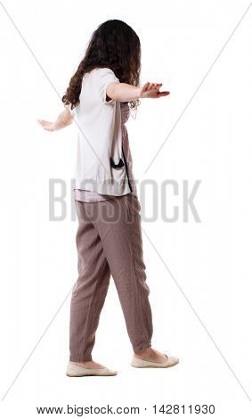 Back view woman is balancing on a tightrope.   Standing young girl in parka. Rear view people collection.  backside view of person.  Isolated over white background. Long-haired curly girl walking on a