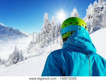 Backside view of skier looking at beautiful winter landscape