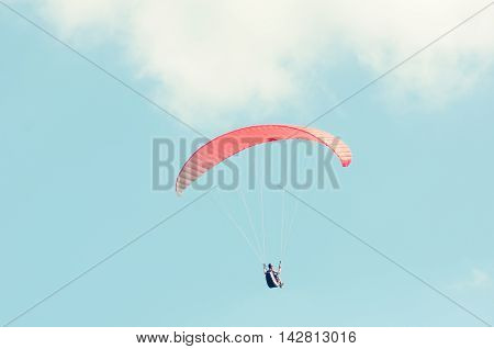 Paraglider Flying Up With Red Wing