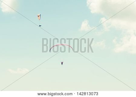 Two Paraglider In The Sky In Sun Light