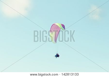 Tandem Paragliders Flying Up In The Blue Sky