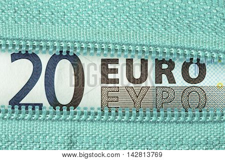 Business money concept with twenty Euro and zipper
