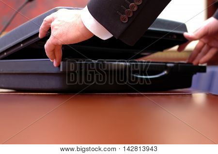 Close up of open briefcase at the start of the business meeting business concept