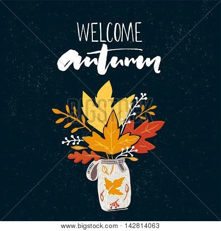Welcome autumn banner with brush calligraphy and drawing of posy of the golden leaves. Vector fall design with inspiration saying