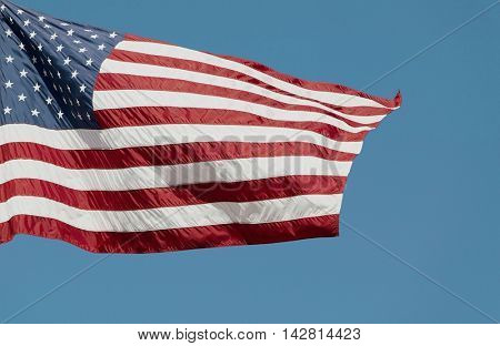 US Stars and Stripes Flag on blue background
