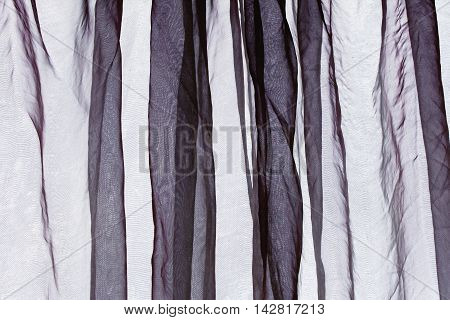 Voile crumbled folded curtain background in gray purple