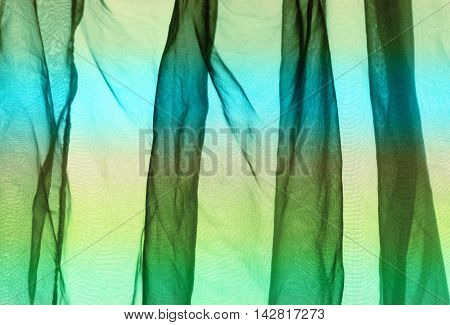 Voile curtain background in striped green blue yellow