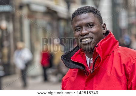 Budapest Hungary - April 11. 2016: Big guy with a big smile at the street posing in front of camera