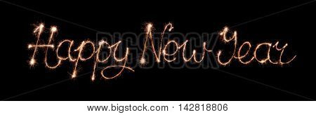 Happy new year text made from sparklers firework light